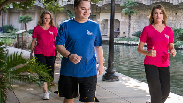 Employees jogging on the san antonio riverwalk