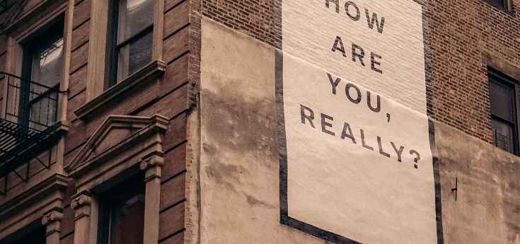 "Wall mural that says, ""How are you, really?"""