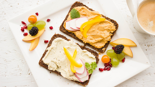 sandwich with spreads and fruit