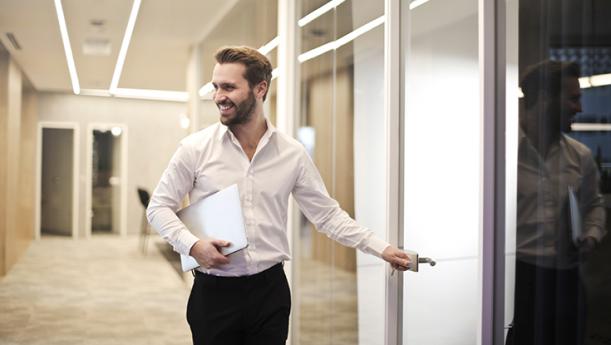 happy employee entering conference room