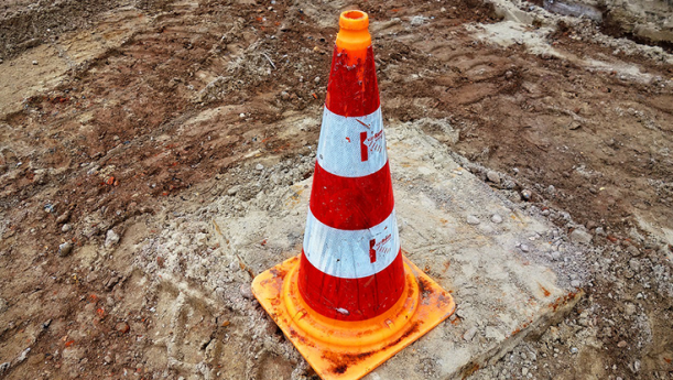 traffic safety cone at construction site on concrete slab