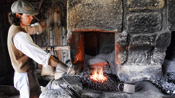 blacksmith working with fire oven