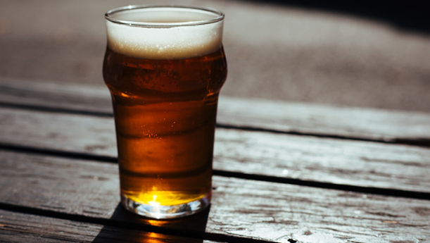 beer in glass on wooden table
