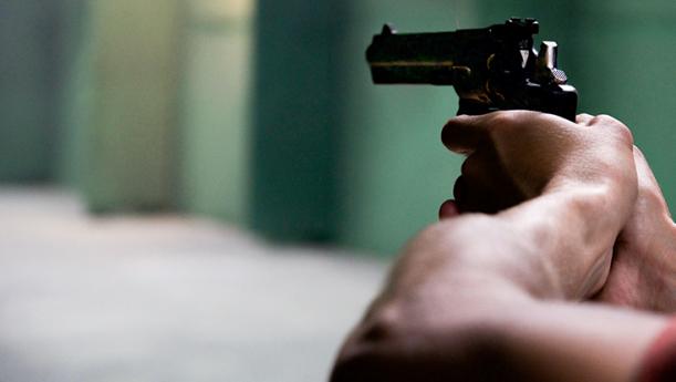 man aiming revolver