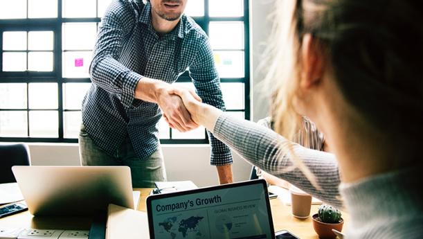 work employees shaking hands