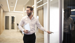 happy employee entering conference room