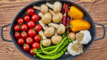 healthy vegetables and food in cast iron skillet